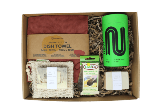 Authentic House eco-friendly subscription box full of sustainable goodies, top view