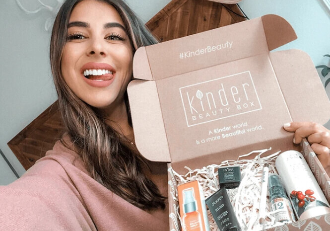 Kinder Beauty Box founder Daniela Monet taking a selfie with a box full of goodies