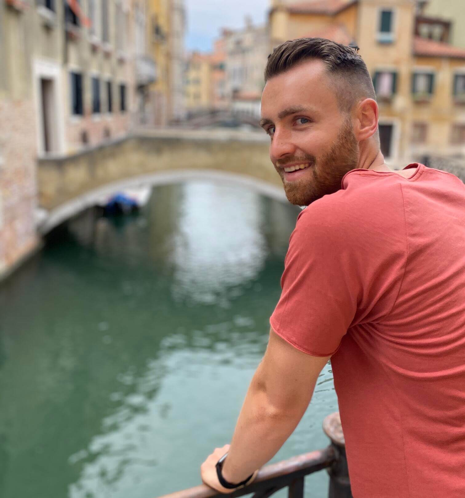 keylight project manager Florian pictured smiling at a water canal in Venice, Italy