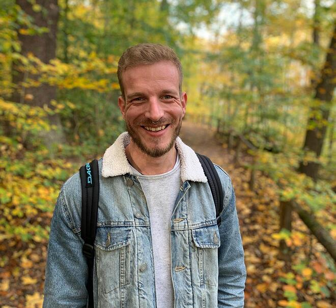 keylight team memeber Andre pictured smiling in a forest